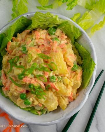 Hawaii style potato salad in white bowl ready to eat