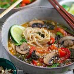 Thai red curry ramen in bowl with chopsticks