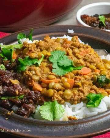 spiced lentils with raisin chutney in brown bowl