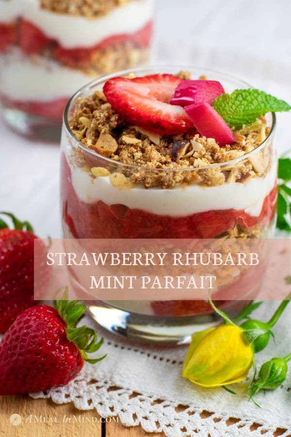 strawberry rhubarb mint parfaits in glasses on white cloth