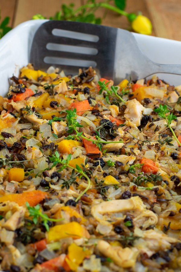 butternut squash chicken rice bake side view with spatula