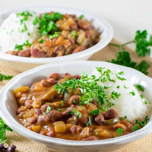 pinterest square image of savory red beans and rice 2 ways gluten free in white bowls