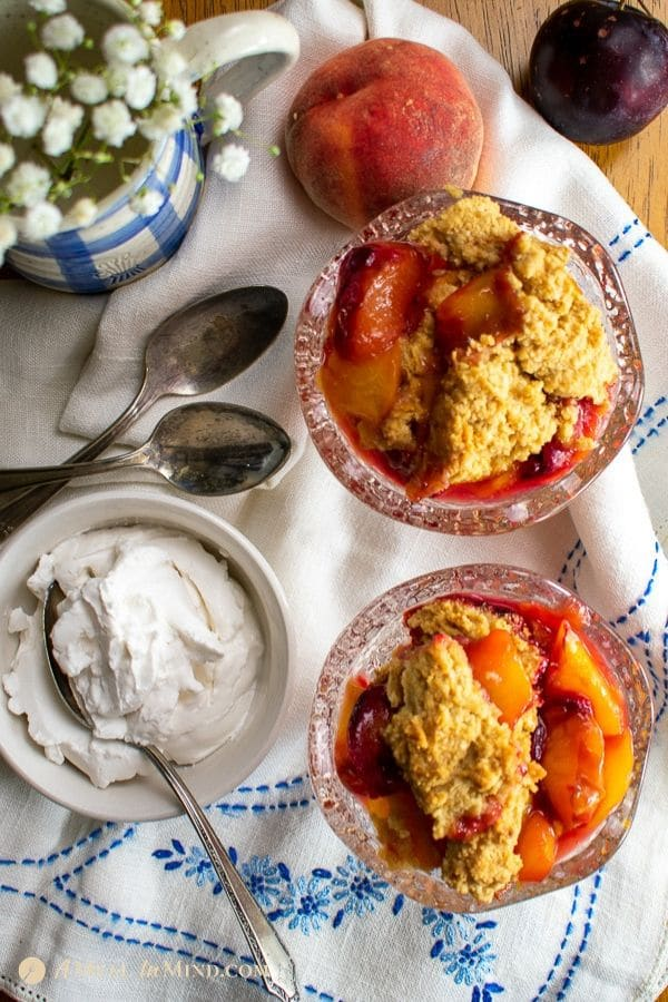 overhead view of mouthwatering peach-plum cobbler in glass dishes