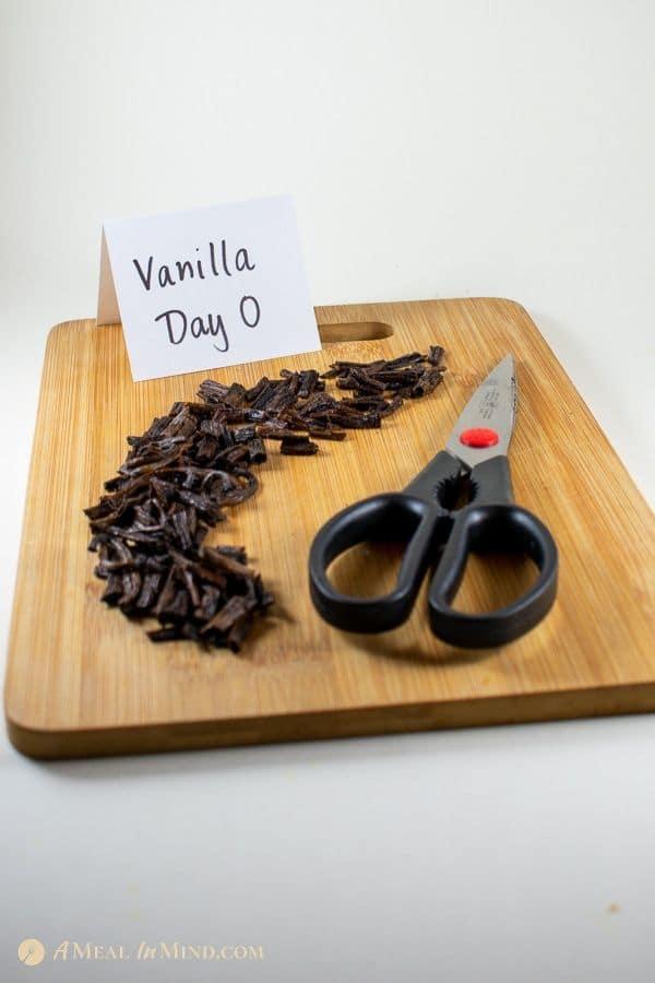 cut-up vanilla beans on wooden board