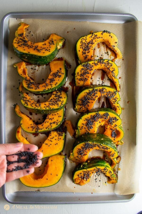 roasted kabocha with black sesame to be cooked on baking tray