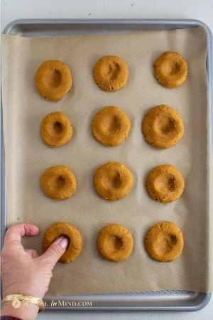 pumpkin cookie thumbprints being made