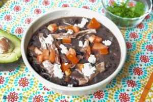 Green chile chicken enchilada soup with tomatoes and feta cheese