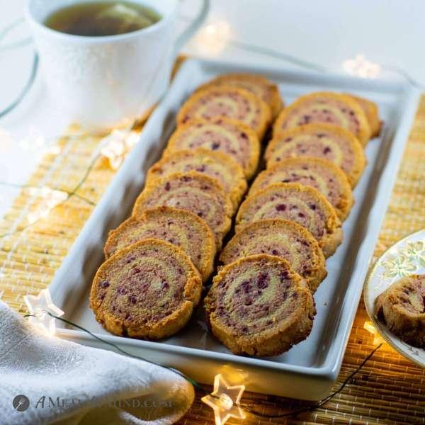 cranberry almond flour pinwheel cookies on white plate