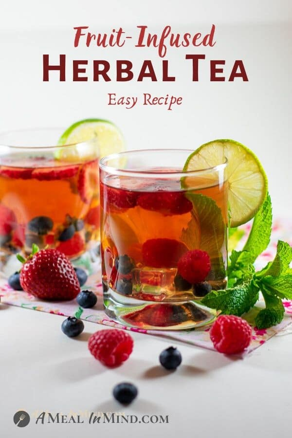 fruit infused herbal tea in clear glasses with fruit garnish