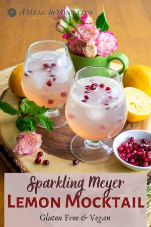 sparkling Meyer lemon mocktail in glasses with pomegranate seeds