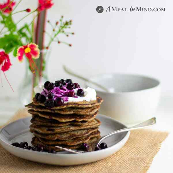 Buckwheat-Currant Pancakes Gluten Free stack on white plate