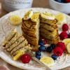 Oat-Hemp Protein Pancakes with fruit stacked on white plate