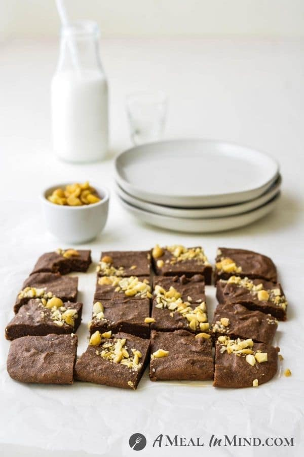 "Macadamia Nut""Ella"" Brownies 3 Ingredient with brownies cut and on table with small plates"