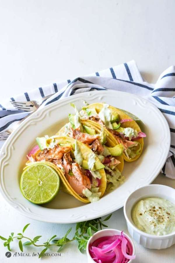 Parchment-Roasted Salmon Tacos on white platter