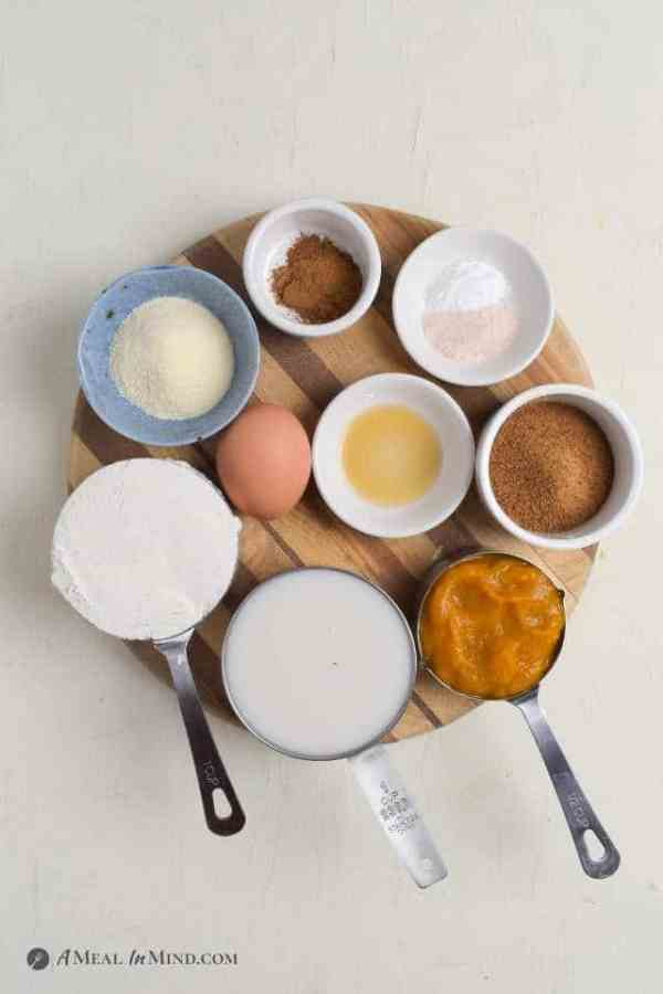 ingredients for Pumpkin Protein Pancakes on wooden board