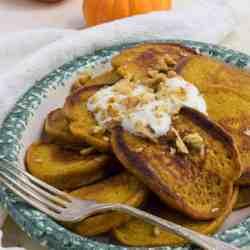 Pumpkin Protein Pancakes on ceramic platter