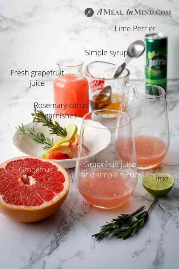 ingredients for rosemary-grapefruit paloma mocktail on marble table