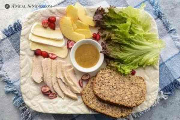 ingredients for chicken-apple-brie sandwich on platter