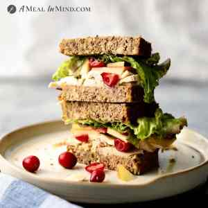 paleo chicken-apple-brie sandwich on plate