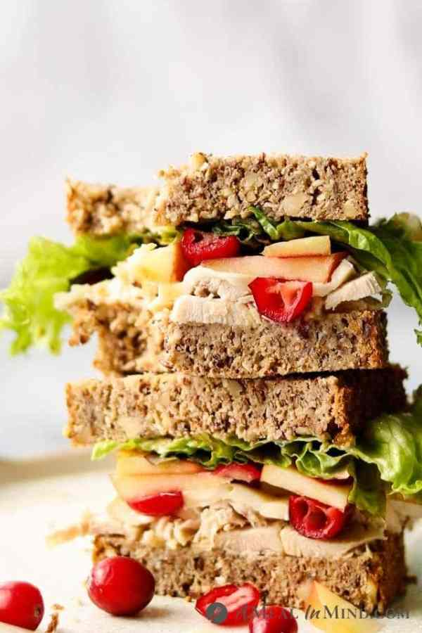 stacked chicken-apple-brie sandwich on Paleo seed bread