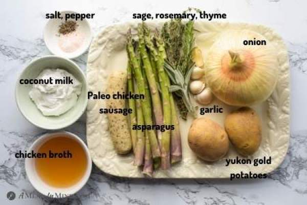ingredients for creamy asparagus sausage soup on white platter