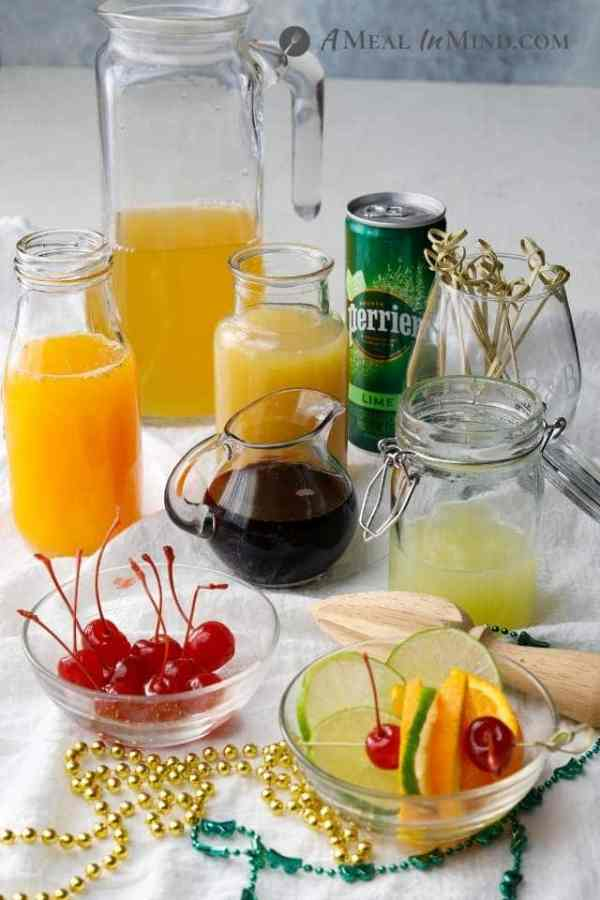 main ingredients for hurricane mocktails in glass containers