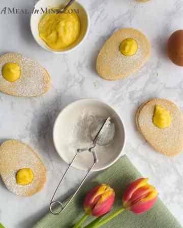 egg-shaped Paleo easter cookies filled with lemon curd