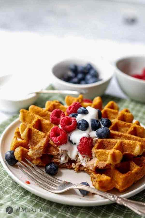 paleo waffles with fruit and yogurt and bites cut out