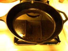 Remove heated skillet from the oven.
