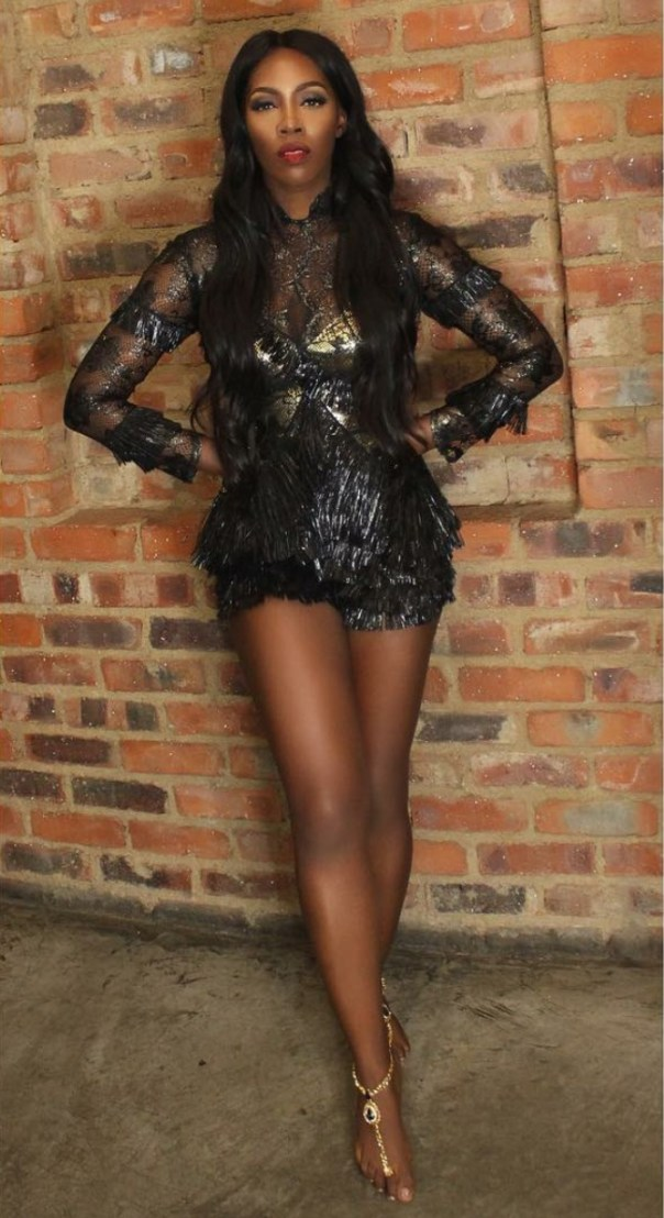 Tiwa Savage Gets Goosebumps As She Channels Her Inner Amazon Queen In Black And Gold Fringed Raffia Playsuit 2