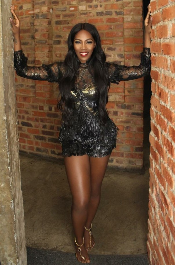 Tiwa Savage Gets Goosebumps As She Channels Her Inner Amazon Queen In Black And Gold Fringed Raffia Playsuit 4
