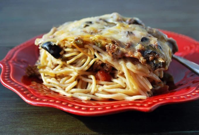 plate of baked spaghetti casserole with a fork