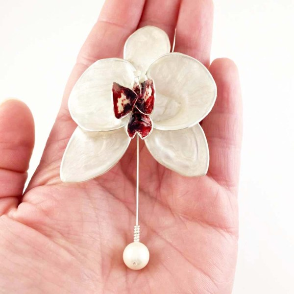 Single white orchid brooch