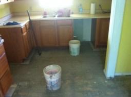 Kitchen after pulling tile