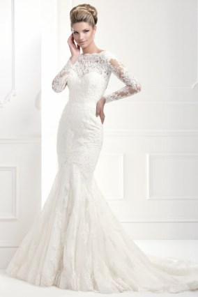 11368 - Fitted fishtail gown with beaded lace, sheer sleeves and keyhole back. A flattering fit for hourglass figures.