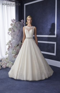 Elina - A TRADITIONAL SILHOUETTE WITH ILLUSION NECKLINE AND BACK DETAIL. THE LAYERED SKIRT, LACE MOTIFS AND BEADED TIE SASH ADD REAL ELEGANCE