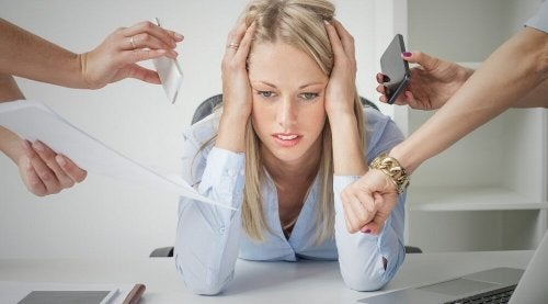 "Woman stressed at work ""width ="" 500 ""height ="" 277 "" data-recalc-dims="