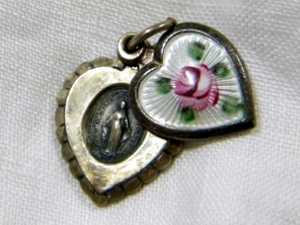 Slide locket with Virgin Mary. Probably from grandma
