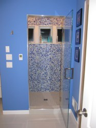 The paint color for this dramatic master bath came from the cobalt blue glass pebble tile in the shower.