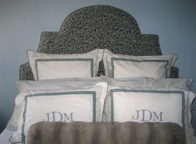 We custom designed this unusual shaped headboard covered in pearl grey cut velvet damask.