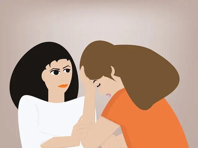 悩める女性と慰める女性