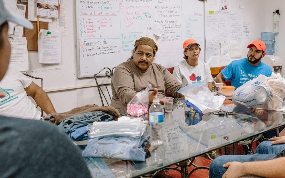 Puerto Rico: Dr. Jose 'Chaco' Vargas Vidot, center, speaks to volunteers before they head out on their Friday night rounds