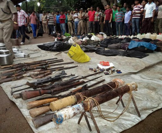 Arms seized from alleged Maoists are displayed at the district police headquarters after a gun battle with the guerrillas near Padia, on the border of Odisha and Chhattisgarh states, on Sept. 14, 2013.
