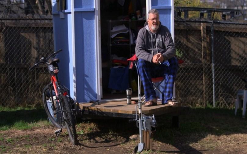 Peter Regan outside his home