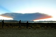 View from the Nahuel Huapi lake, province of Rio Negro, 1570 km southwest of Buenos Aires, of a menacing cloud from the Calbuco volcano in neighbouring Chile, on April 22, 2015. Chile's Calbuco volcano erupted on Wednesday, spewing a giant funnel of ash high into the sky near the southern port city of Puerto Montt and triggering a red alert. Authorities ordered an evacuation for a 10-kilometer (six-mile) radius around the volcano, which is the second in southern Chile to have a substantial eruption since March 3, when the Villarrica volcano emitted a brief but fiery burst of ash and lava. AFP PHOTO/FRANCISCO RAMOS MEJIA