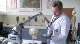 3-D laser scanning a skull.