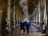French President Emmanuel Macron and Paris Mayor Anne Hidalgo, left, walk together to attend a ceremony at the Paris city hall, France, Sunday, May 14, 2017. (Charles Platiau/Pool Photo via AP)