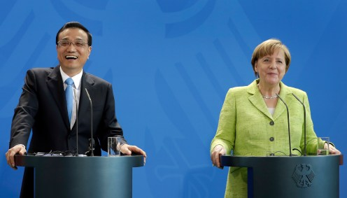 German Chancellor Angela Merkel, right, and China's Premier, Li Keqiang, left, address the media during a joint press conference as part of a meeting at the chancellery in Berlin, Germany, Thursday, June 1, 2017. (AP Photo/Michael Sohn)
