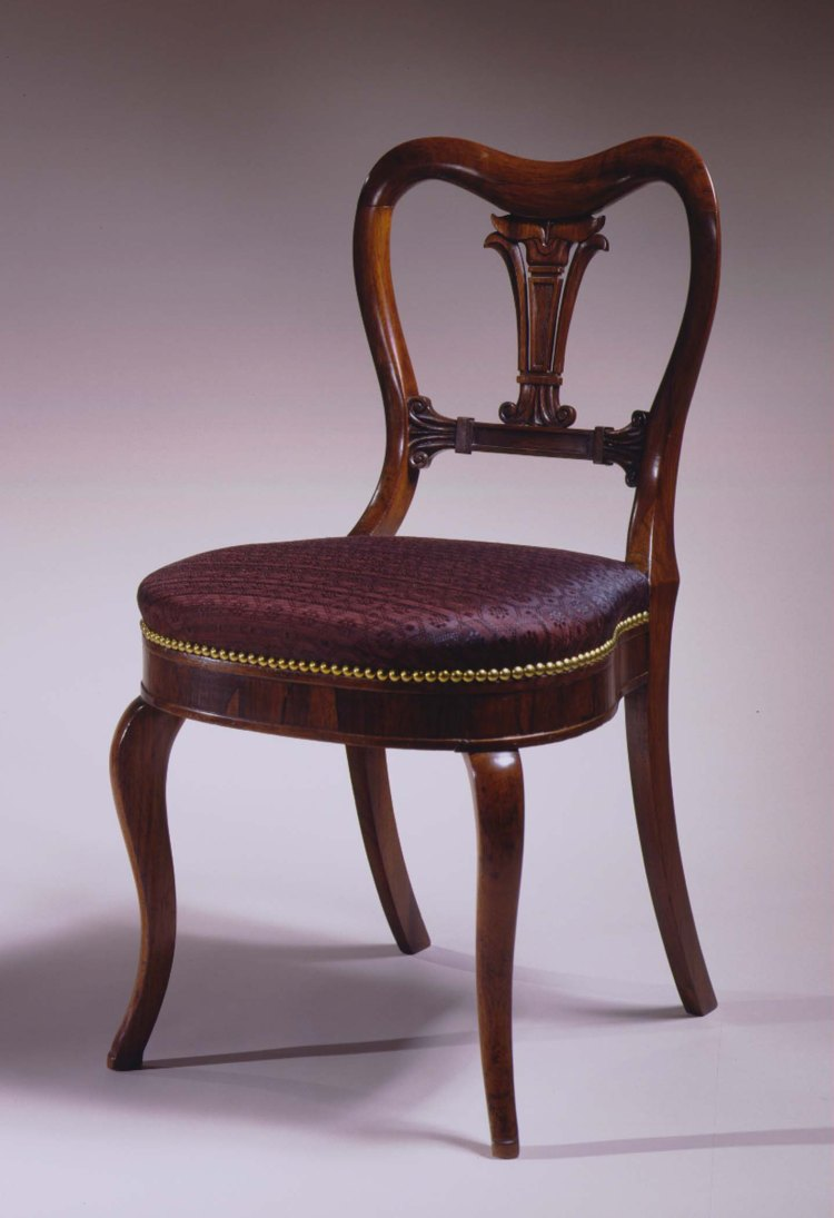 "Pair of Restauration Side Chairs by Phyfe: The oxbow shaped crest rail above a vertical central carved and pierced splat above a lotus carved stay rail with an upholstered balloon seat on cabriole front legs. H: 32¾""   W: 17½""  D: 18"""