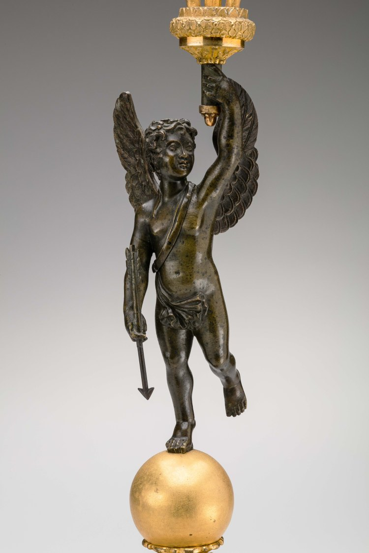 Pair of Restauration Gilt-Bronze Candelabra Detail of winged cherub holding an arrow in his other hand.
